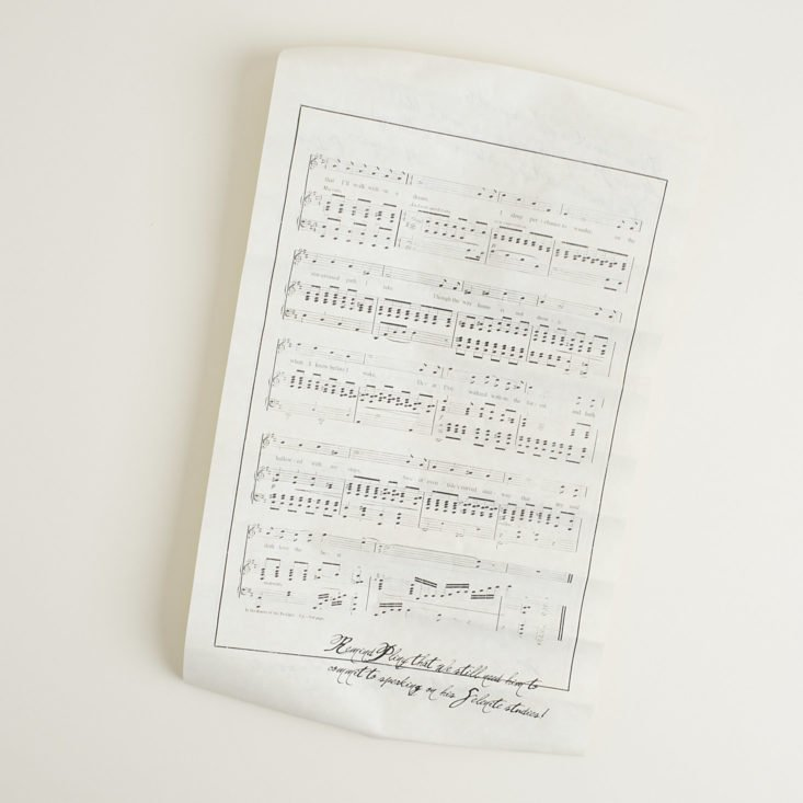 back of unrolled scroll featuring sheet music