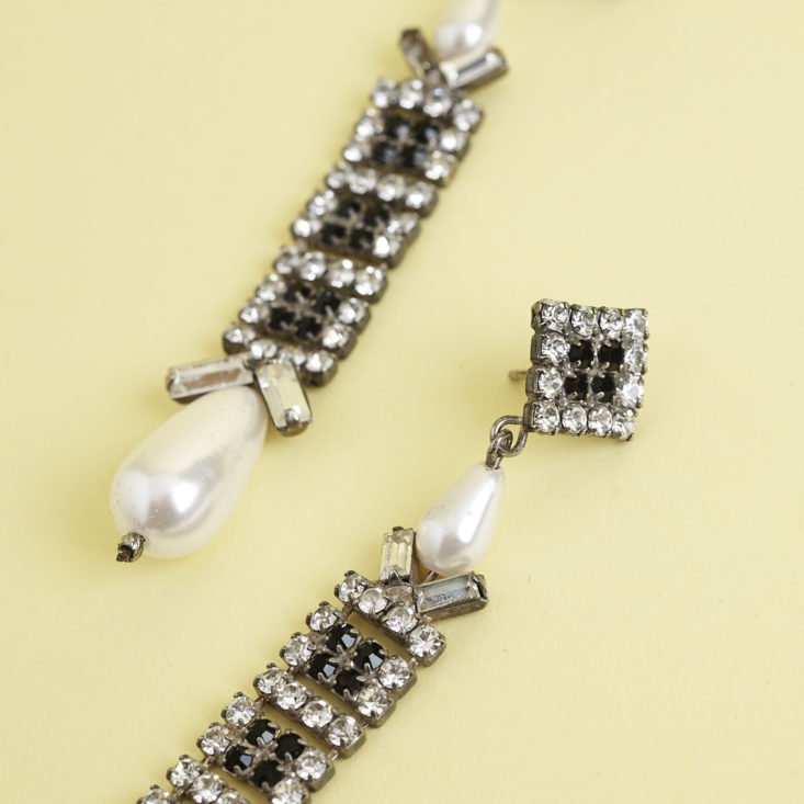 close up of top of 1930s pearl costume jewelry earrings