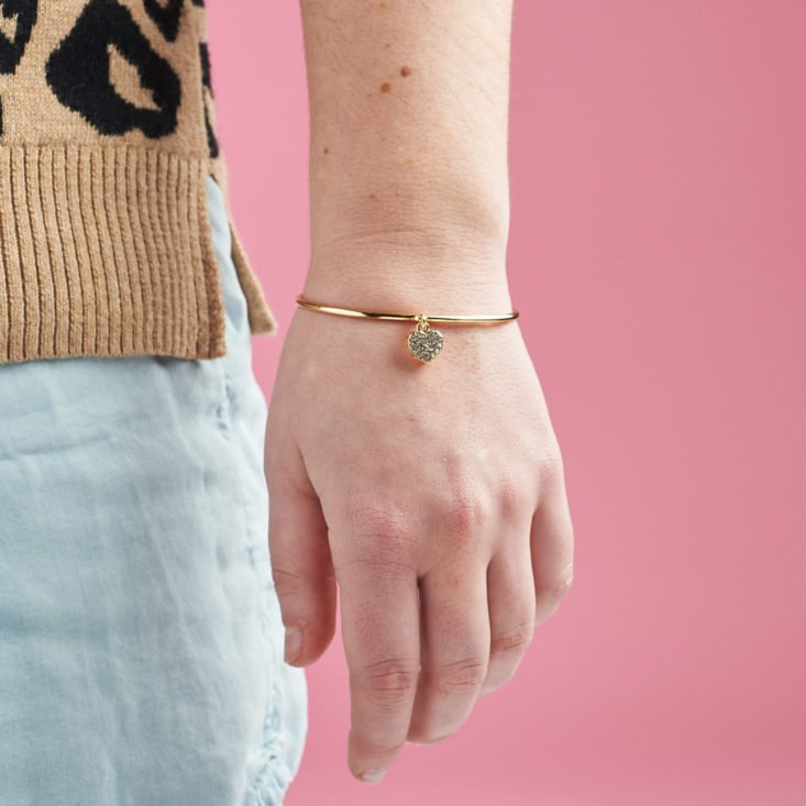 gold bracelet on person