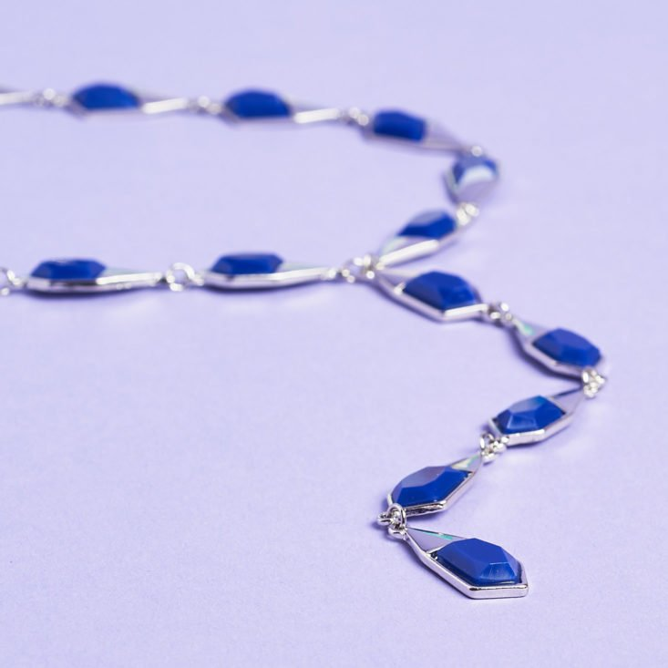 blue chain necklace laid flat