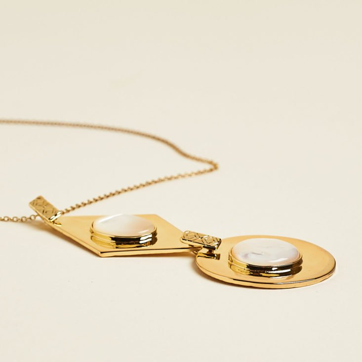 gold pendant necklace laid flat