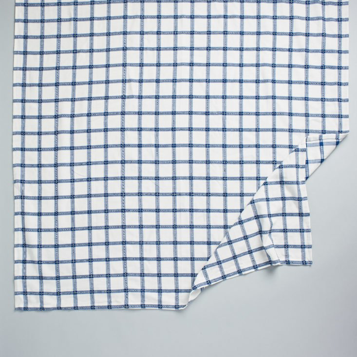 This blue gridded dish towel is lightweight and classic.