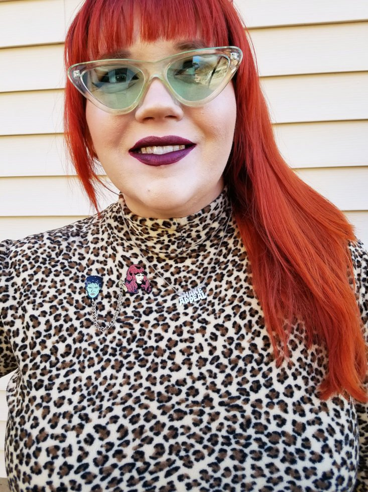 close upof model wearing Poison Ivy Rorschach Leopard Print Mini Dress and sunglasses