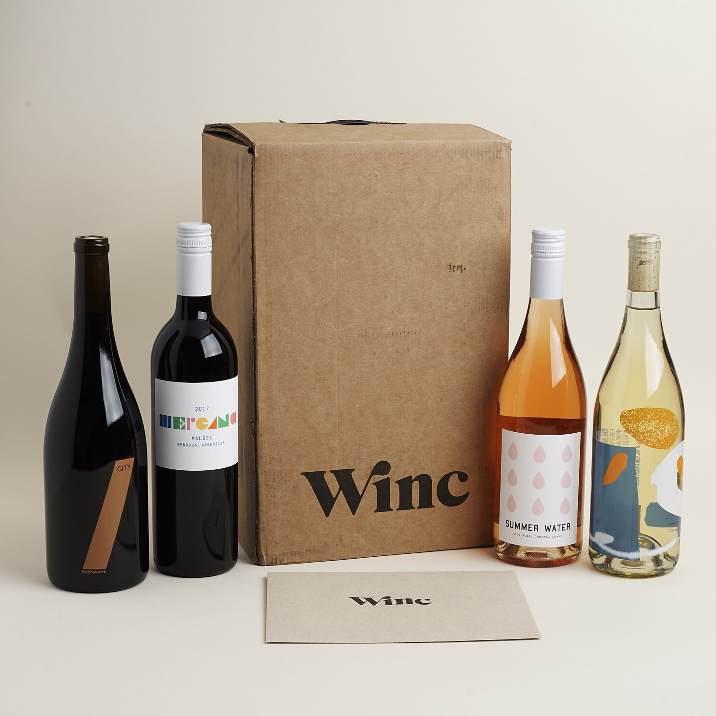 4 bottles of wine with winc box