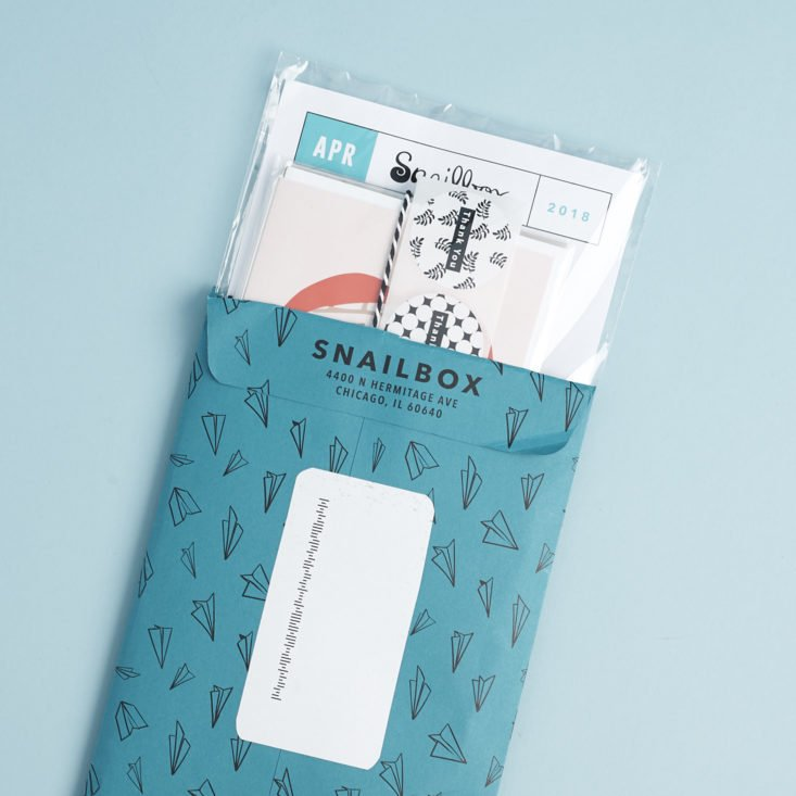 Snailbox envelope with items popping out