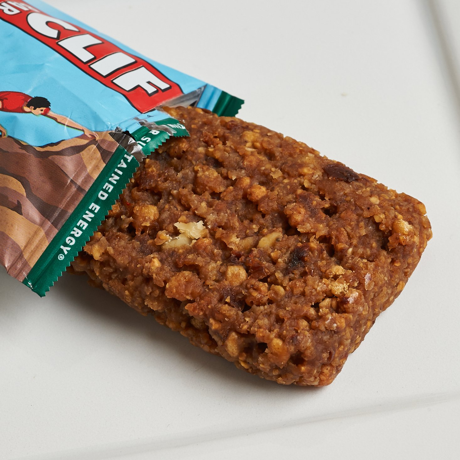 Oatmeal Raisin Walnut Clif Bar coming out of package onto plate
