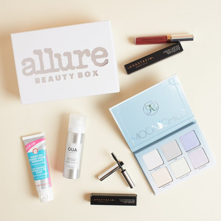 Allure Beauty Box shown with highlighter palette, lippie, mascara, and more